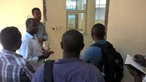 Emmanuel Azore shows the IT team around the new microbiology laboratory.